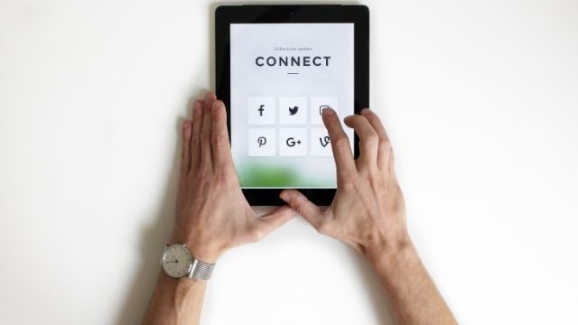 An iPad showing social media platforms used for influencer marketing brand strategy.