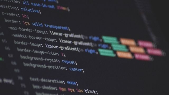 A computer screen displaying lines of code for a highly customized web design